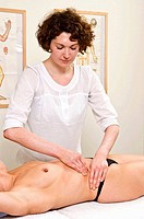 WOMAN BEING MASSAGED Models. Slimming and anti_cellulite massage. The massager uses the technic of palpate and roll that consists in pinching a fold o...