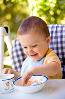 CHILD EATING A MEAL Model. 16_month_old boy.