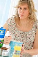 WOMAN EATING BREAKFAST Model.