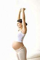 Pregnant woman stretching hands