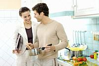Young couple smiling in kitchen