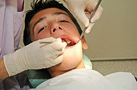 DENTAL CARE, ADOLESCENT Location of a tooth decay.