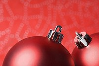 Two red Christmas tree ornaments, close-up (thumbnail)