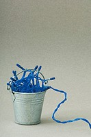Miniature bucket filled with blue Christmas tree lights (thumbnail)