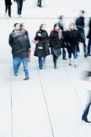 Pedestrians walking across public square