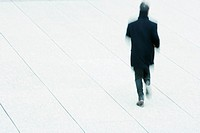Pedestrian walking across public square (thumbnail)