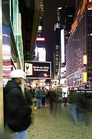 Sidewalk scene on Broadway in New York City looking north at Times Square