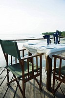 Casual dinner table overlooking sea