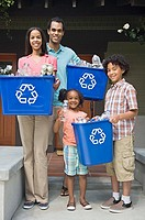 Family with recycling bins