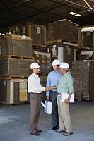 Businessmen meeting in warehouse
