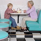 Woman and grandson sharing a banana split
