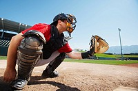 Catcher holding baseball in mitt