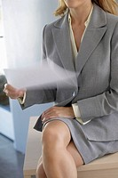 Nervous businesswoman holding document