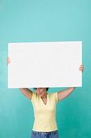Woman holding blank erase board
