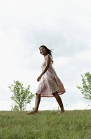 Woman walking in a meadow