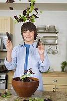 Boy tossing salad