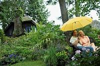 Couple sitting in garden