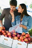 Couple shopping for fruit