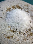 Coarse sea salt on a stone