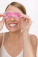 Woman with a cooling eye mask