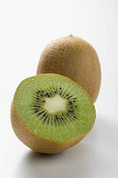 Whole kiwi fruit and half a kiwi fruit