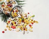 Assorted pills spilling from bottle