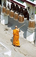 Buddhist monk ringing bells, Wat Phra Phutthabat Temple, Wat Phra Buddhabat, near Lopburi, Saraburi Province, Thailand