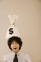 Man with money bag on head