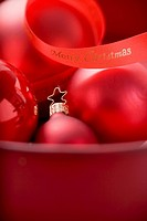 Red Christmas baubles with ribbon