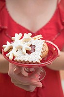 Woman holding dish of Christmas biscuits