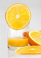 Glass of orange juice and orange slices