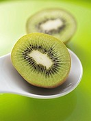 Two halves of a kiwi fruit
