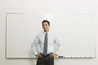 Man in front of blank white board