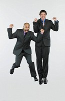 Excited jumping businessmen