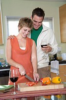 Mid_adult couple preparing food together