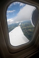 Landscape viewed through a window of an airplane