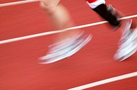 Close_up of the lower legs of a disabled athlete while running in a track event at the 2003 British Open Athletics Championships games. The athlete ha...
