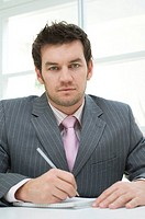 portrait of businessman making notes