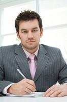 portrait of businessman making notes