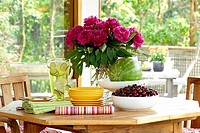 Table Setting with Fruit, Peonies and Lemonade on Table, Victoria, British Columbia