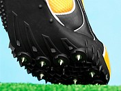 Close up of a Spiked Sports Shoe on Artificial Grass
