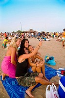 People at El Aborigena refreshment stall in the evening, El Palmar. Cadiz province, Andalucia, Spain