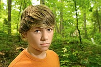 Teenage boy in woods