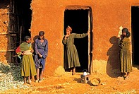 Ethiopia, near Bahar Dar, Amhara women by traditional house