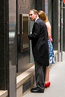 Yuppie couple in front of bank counter, man with tailcoat, Vienna, Austria