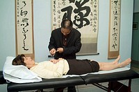 Chinese doctor performing acupuncture