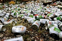 Pollution, deposit of cans of beer in a piece of waste land. Brussels, Belgium