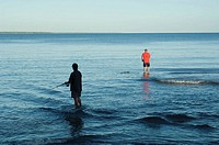 Two fishermen casting in Fannie Bay, Northern Territory, Australia