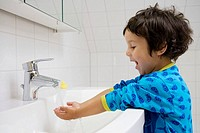 Toddler washing his hands