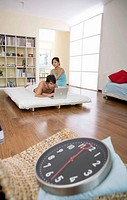 Young couple in bedroom, woman massaging man,